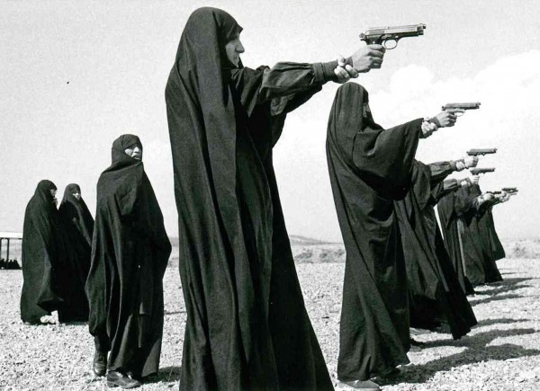 "Postcard ""Jean Gaumy - Veiled woman practice shooting on the outskirts, Tehran, Iran, 1986"""